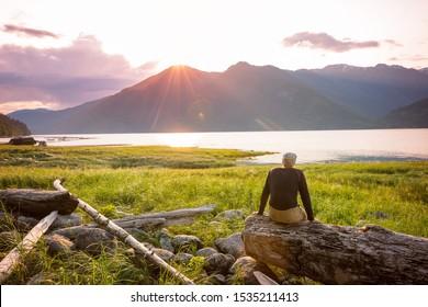 Tourist in Pacific ocean coast in British Columbia, Canada. Wanderlust travel concept.