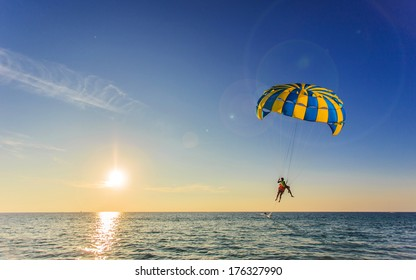 Tourist is para sailing over the blue sea in Thailand