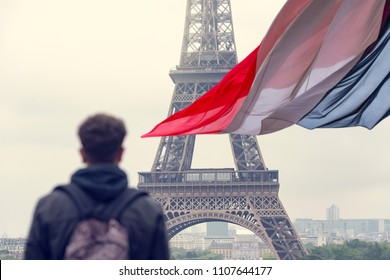 Tourist in Paris Eiffel Tower and French Flag France