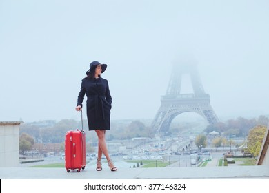 tourist in Paris, Europe tour, woman with luggage near Eiffel Tower, France