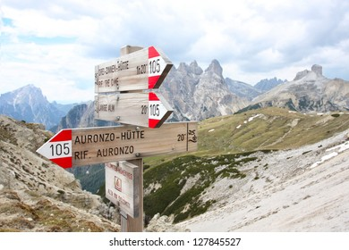 tourist paths directions and travel time shown on a traditional direction signs at the Dolomiti mountains, Italy
