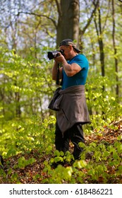 tourist photographing the forest in spring day