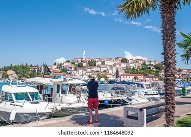 Tourist photographs Vrsar Harbor on the Adriatic sea in Istria, Croatia.