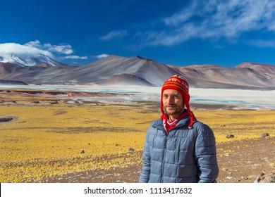 Tourist in Piedras Rojas, altiplano in the Atacama Desert, Chile.