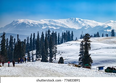 Tourist preparing for Skiing on Snow Covered Himalayan Mountains in Gulmarg, Jammu and Kashmir, India