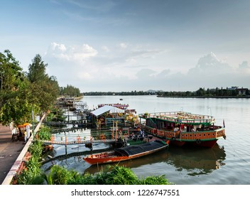 tourist restaurant boats and landscape at riverside in central kampot town cambodia