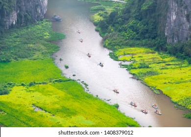 Tourist ride boat for sight seeing rice field on Ngo Dong river at Tam Coc, Ninh Binh, Vietnam
