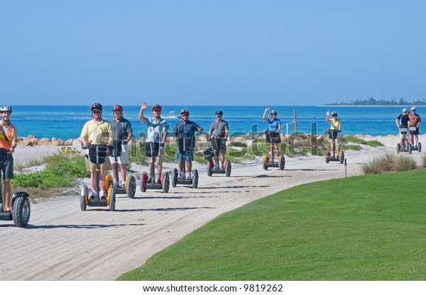 Tourist riding the Segway personal transport vehicle at a resort