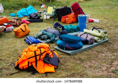 tourist set on a green lawn for a hike in an expedition, with utensils for cooking food outdoors, camping equipment for camping on the grass, on a white sheet
