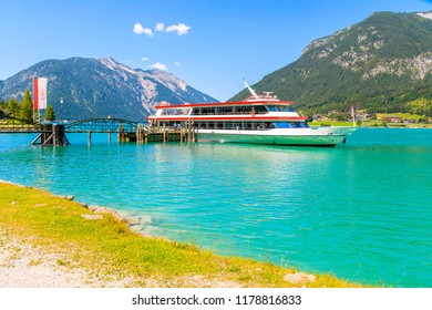 Tourist ship mooring at pier on shore of Achensee lake on sunny summer day, Tirol, Austria