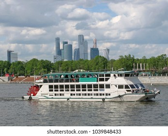 Tourist ship on the background of the international business center of Moscow, Russia