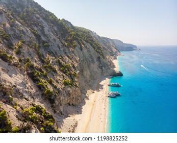 Tourist ship on the Egremni beach, Lefkada, Greece.