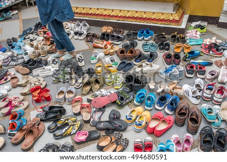 af18c5edad87 The tourist shoes at the temple. This picture is taken on 5 October 2016 at