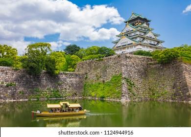 Tourist sightseeing Boat ride around the Osaka Castle.