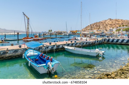 Tourist sight-seeing boats docked in Cabo San Lucas, Baja California, Mexico
