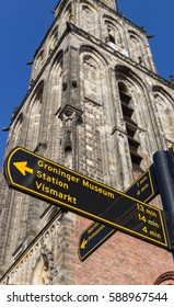 Tourist sign in front of the Martini tower in Groningen, Holland
