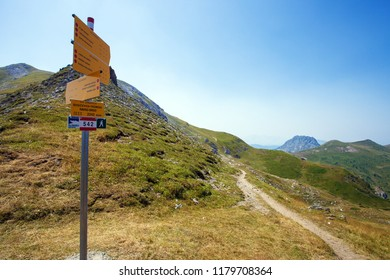 Tourist sign on a trail with description of main hiking path in a mountains