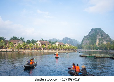 tourist sitting on boat for travel around Tam Coc beatiful nature river and mountain, Tam Coc Ninh Binh, Vietnam. subject is blurred.