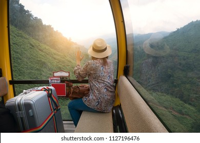 Tourist is sitting on Cable car during travling on Bana Hills in Danang, Vietnam.