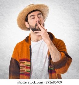Tourist smoking over grey background
