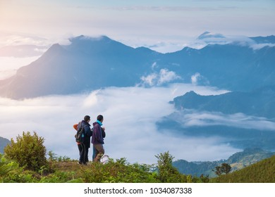 Tourist are standing on the peak of Phu Chi Dao or Phu Chee Dao cliff in morning