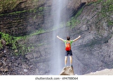Tourist stands close in the Front of  the Gocta waterfall in nothern peru Gocta Waterfall/ Chachapoyas/ Peru/ south america