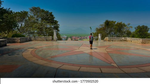 Tourist stands on top of D1 Hill looks at city of  Dien Bien Phu Vietnam