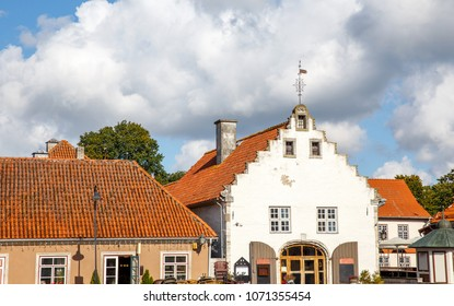 Tourist street, street from medieval houses against a blue sky with clouds, Saaremaa island, Estonia