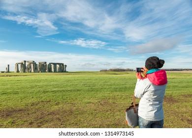 Tourist takes photos at Stonehenge