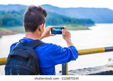 Tourist taking mobile shot