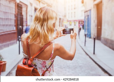 tourist taking photo on the street