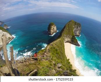 Tourist taking a photograph on Kelingking Beach in September 11, 2018 at Nusa Penida, Bali Indonesia