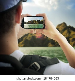 tourist taking photos  with mobile phone