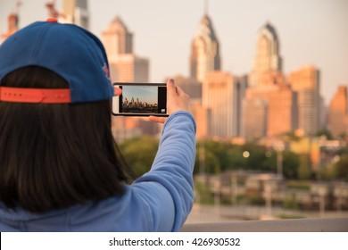 Tourist taking photos in Philadelphia