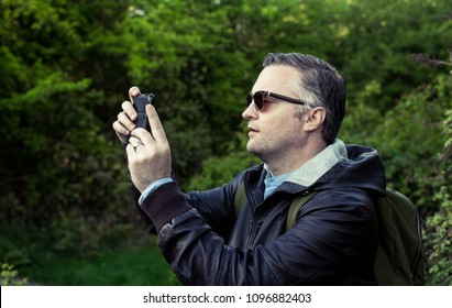 a tourist taking pictures in Hadleigh Park, Essex, UK