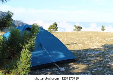 tourist tent of blue color on top of Mount Ai-Petri in Crimea, Russia. Wonderful mountain landscape with a hiking storyline