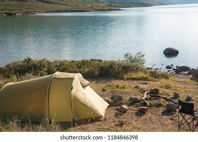 tourist tent in camping at beautiful Gjende lake, Besseggen ridge, Jotunheimen National Park, Norway