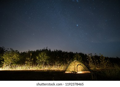 Tourist tent camping and milky way at lake side in Thailand