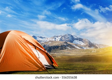 tourist tent camping in mountains concept
