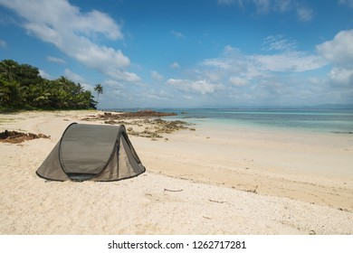Tourist tent camping on sand beach