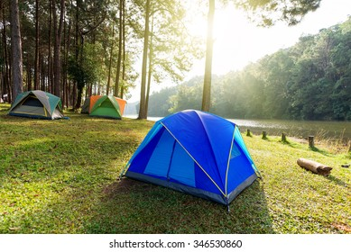 tourist tent in forest camp with sun rise
