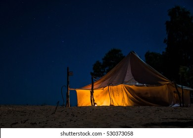 Tourist tent with a lantern light under the stars in the african desert