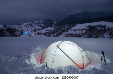 Tourist tent in night winter mountains. Carpathians