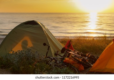 tourist tent on the beach, camping with tents in the summer