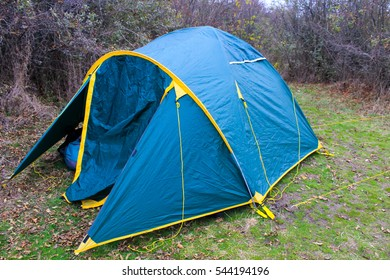 Tourist tent on the lawn in the forest
