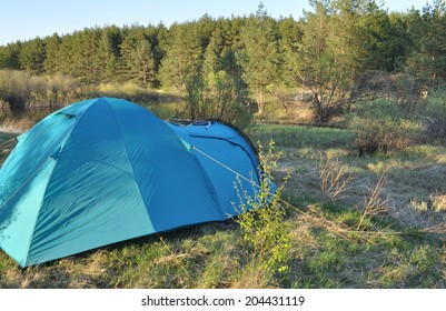 """Tourist tent, put on spring grass in the national Park """"Meshchera"""" in the Ryazan region, Russia."""