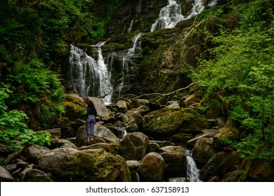 Tourist at Torc Waterfall in Killarney National Park,Kerry,Ireland