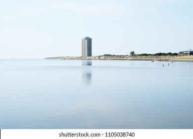 tourist town Buesum on the north sea coast in Germany, panoramic view with beach and skyscraper