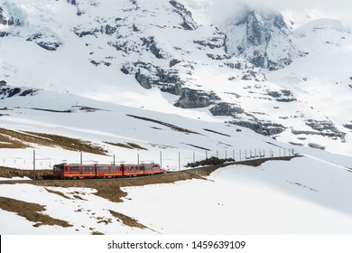 Tourist train to Jungfraujoch (Top of Europe) mountain with side way full of snow