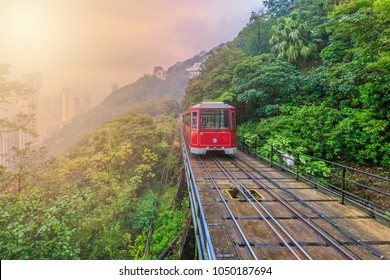 Tourist tram at the peak famous railroad train downtown on forest hill, Victoria peak tram and Hong Kong city skyline and skyscraper building construction architecture, Kowloon, Hong Kong, Asia.